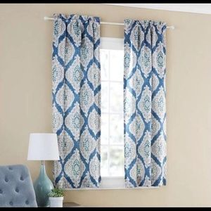 Two sets of blue curtains